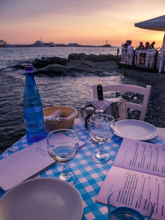 mykonos greece dinner table sunset